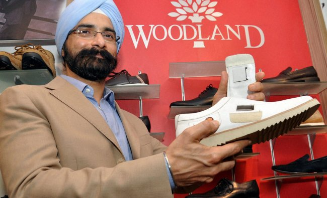 Managing Director of Woodland Harkirat Singh shows new Woodland Tempforest shoes in Kochi, Kerala ..