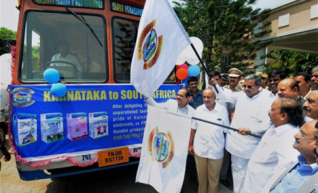 Siddaramaiah flags off a bus to create awareness among people on use of milk products...