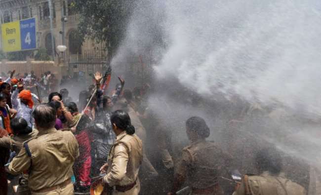 Water cannon being used to disperse BJP Mahila Morcha workers protesting against the Baduan...