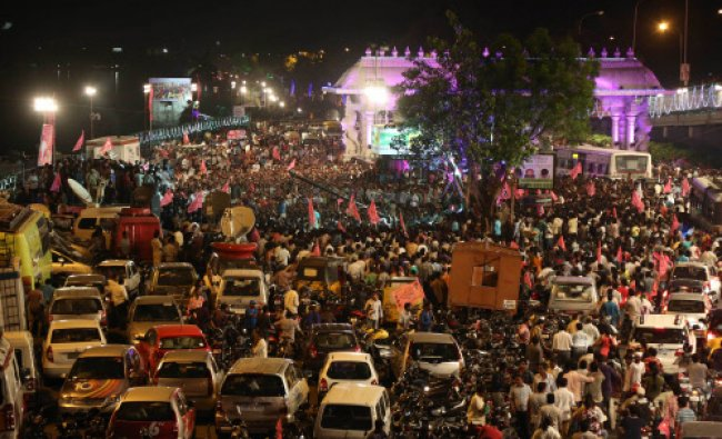 People celebrate on the street the formation of India\'s 29th state, Telangana, in Hyderabad...