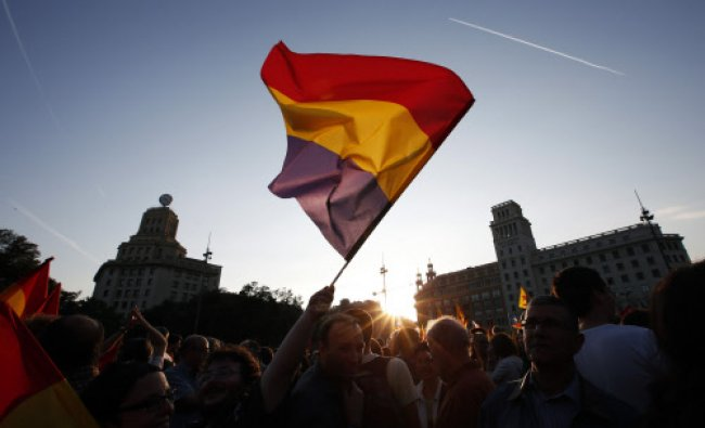 A man waves a Spanish Republican flag during an anti-royalist demonstration at Catalunya square...
