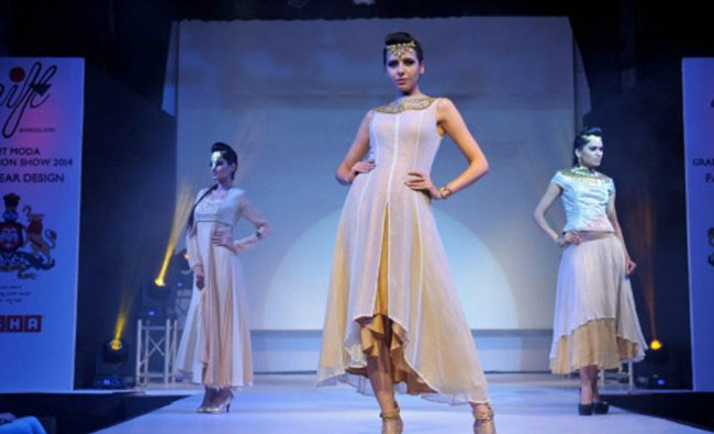 Models walk the ramp to showcase a creation by a student during Fashionova Graduation Show 2014...