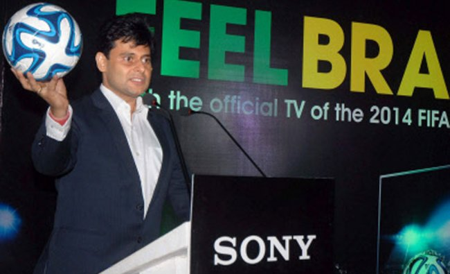 Sunil Nayyar, Head Sales, Sony India holding a replica of FIFA World Cup 2014 foolball during...