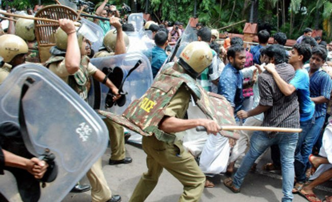 Police lathi charge at SFI workers who were protesting in Kozhikode on Tuesday...