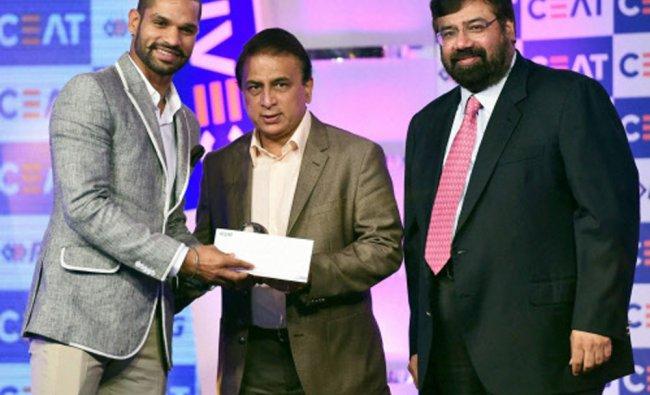 Shikhar Dhawan receives an award from veteran cricketer Sunil Gavaskar and Industrialist Harsh...