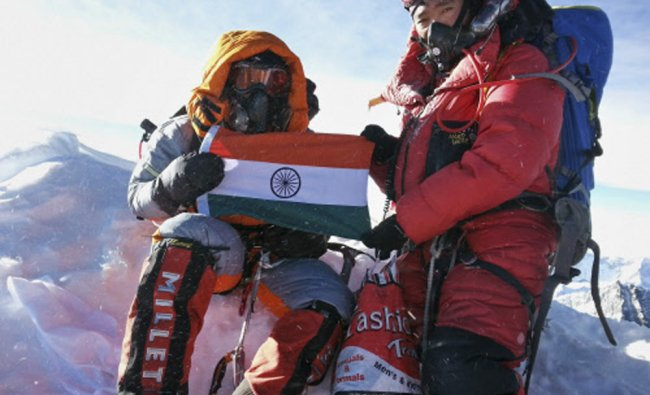 Malavath Poorna, left, holds up her Indian nations flag on Mount Everest, Nepal...