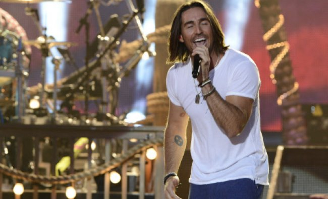 Jake Owen performs on an outdoor stage during the CMT Music Awards on Wednesday, June 4, 2014, in...