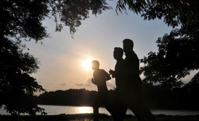 Joggers running by Kukkarahalli Lake in Mysore...
