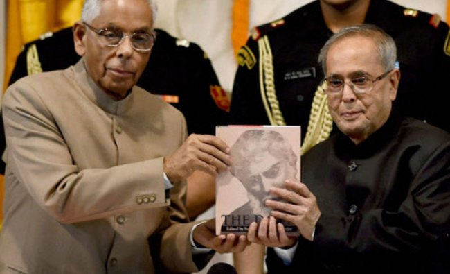 Pranab Mukherjee receives the first copy of the second edition of The Dawn, Volume-I, from WB...