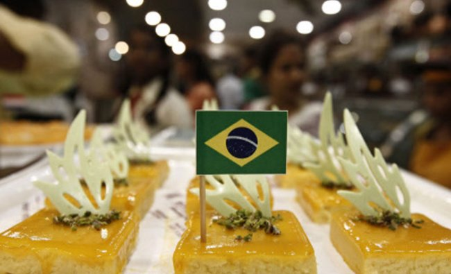 A Brazilian national flag is fixed on a piece of sweet at a sweets shop in Kolkata, ahead of...