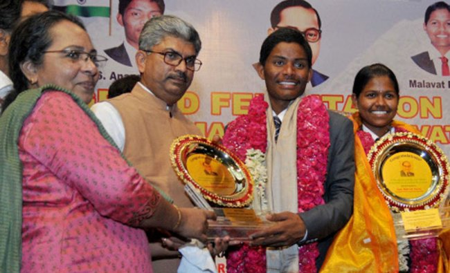 Malavath Poorna and and S. Anand Kumar being felicitated during a function in New Delhi...