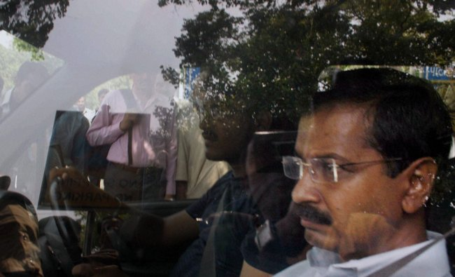 AAP convener Arvind Kejriwal arrives at Patiala House court in New Delhi on Friday ...