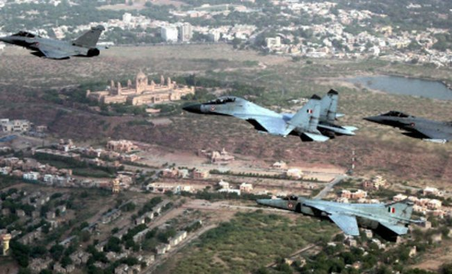 IAF\'s Su 30MK-I and MIG 27 aircrafts perform with French Air Force\'s Rafale aircrafts during...