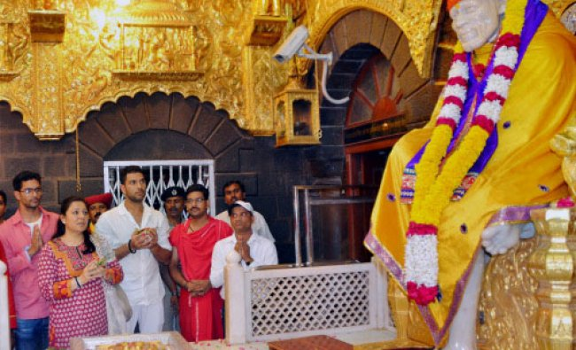 Yuvraj Singh along with his mother Shabnam Singh paying obeisance at Saibaba temple in Shirdi...
