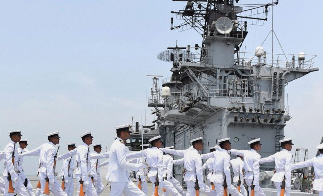 Navy soldiers parade during Defence Minister Arun Jaitley\'s visit to INS Viraat in Mumbai ...