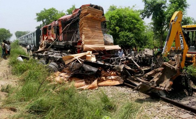 Restoration work is carried out after a train hit a truck at unmanned railway crossing in Pihani ..
