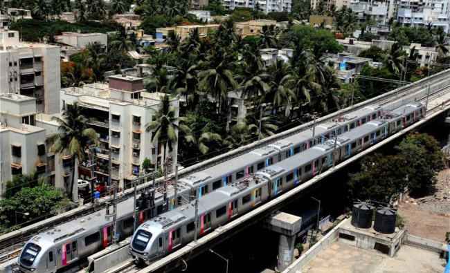 Metro trains running on the tracks in Mumbai on Saturday ...