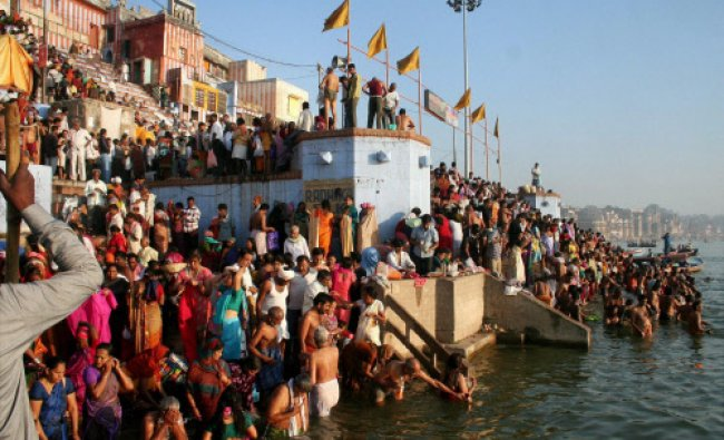 Devotees taking a dip in River Ganga on the eve of Ganga Dashara in Varanasi...