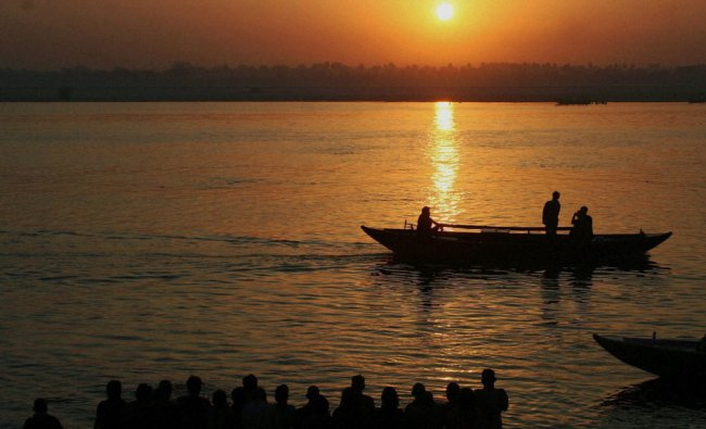 Devotees worshiping in the river Ganga on the occasion of \'Ganga Dussehra\' festival in Varanasi ...