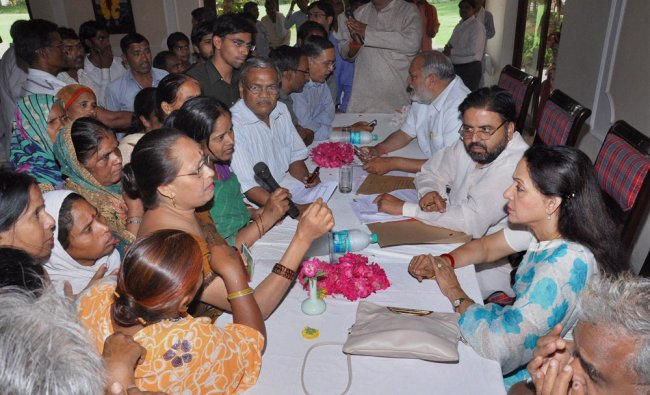 Bollywood actress and MP Hema Malini interacts with public during her \'Janta Darbar\' in Mathura ...