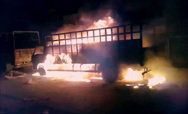 A mob stoned buses and set vehicles on fire after BJP leader Geeta Pandit\'s husband was shot ...