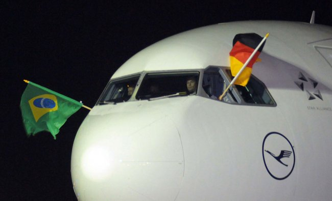 A plane carrying the German national soccer team arrives at the terminal after landing ,Salvador ...