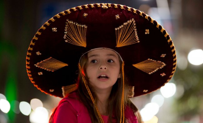 A fan of Mexico wears a traditional Mexican hat awaits the arrival of Mexico\'s national team ...