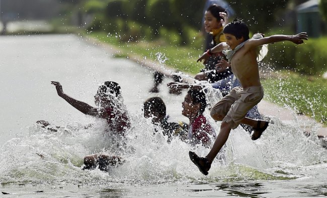 Youngsters beat the heat as mercury soars in New Delhi on Sunday. PTI Photo