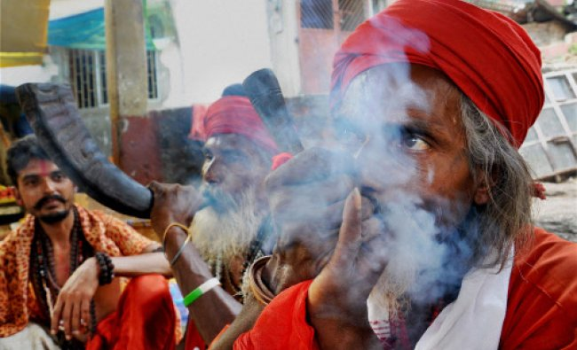 Sadhus at Kamakhya Temple in Guwahati on Sunday. Devotees from across the country have started...
