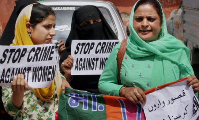 Bharatiya Janata Party workers holding placards during a protest against the alleged molestation...