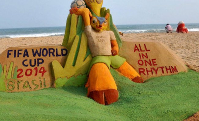 A sand sculpture on FIFA World Cup that was created by sand artist Manas Sahoo at Puri beach...