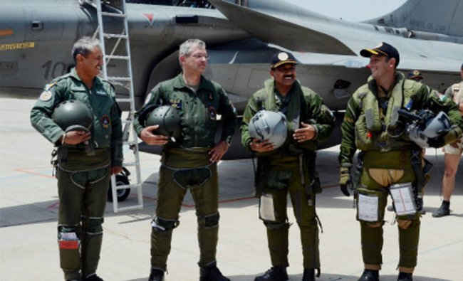 IAF chief Marshal Arup Raha and French Air Chief General Denis Mercier after flying aircrafts...
