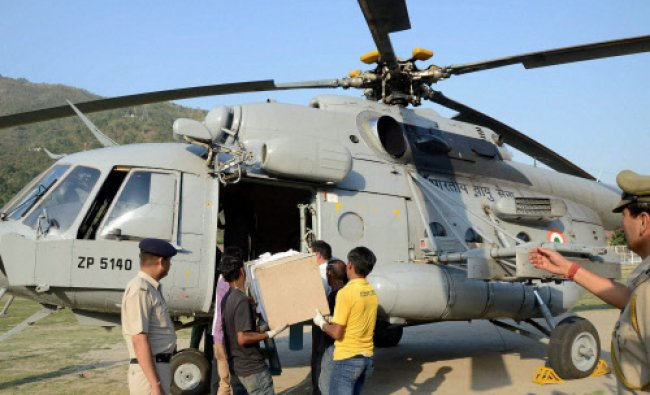 The body of one the engineering students swept away in the Beas River, is loaded in an IAF...