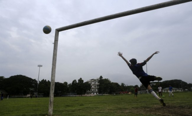 Youth practice soccer in Gauhati, Monday, June 9, 2014. Soccer fans around the world are gearing...