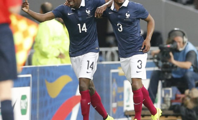 French soccer Blaise Matuidxi, left,reacts after scoring against Jamaica with Patrice Evra during th