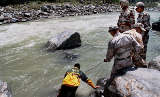 Indo-Tibetean Border police personnel carrying out search operations for the missing Hyderabad...