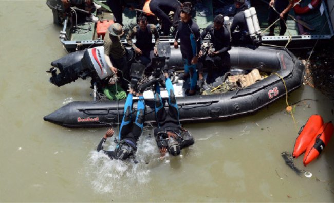 Divers jump into the Bhakra Beas Management Board lake to search for missing Hyderabad-based...