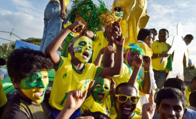 Fans of Brazil\'s football team take out a procession ahead of the FIFA World cup 2014 in...