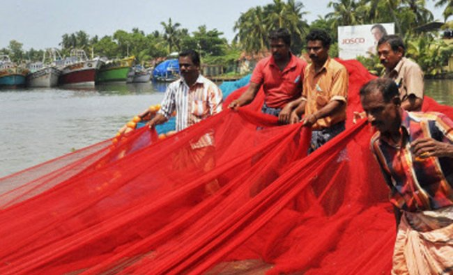 Fishermen gathering their nets ahead of the 47 day ban on fishing trawlers scheduled to begin...