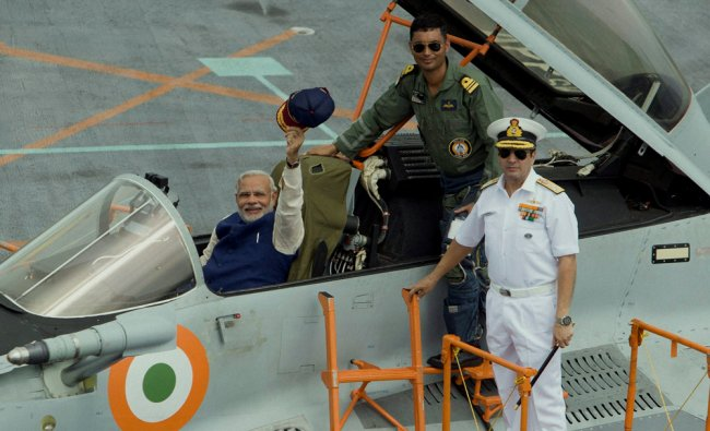 Narendra Modi waves from the cockpit of MIG 29 on the deck of INS Vikramaditya ...