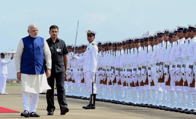 Narendra Modi inspects the Guard of Honour at INS Hansa airbase at Dabolim in Goa ...