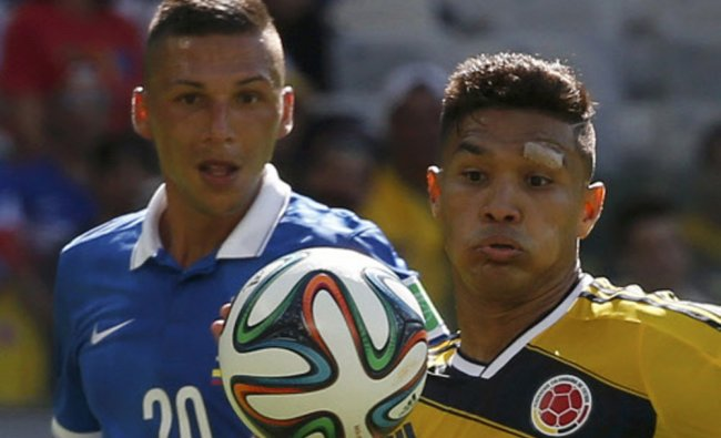 Greece\'s Holebas and Colombia\'s Gutierrez fight for the ball ...