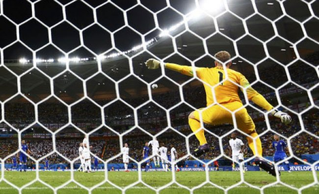 England\'s Joe Hart (front) is sent the wrong way during a freekick taken by Italy\'s Andrea ...
