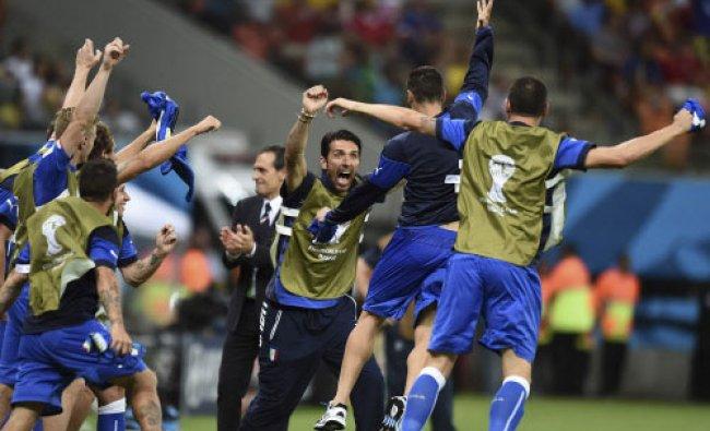 Italian goalie Gianluigi Buffon, face to camera, and coach Cesare Prandelli, center...