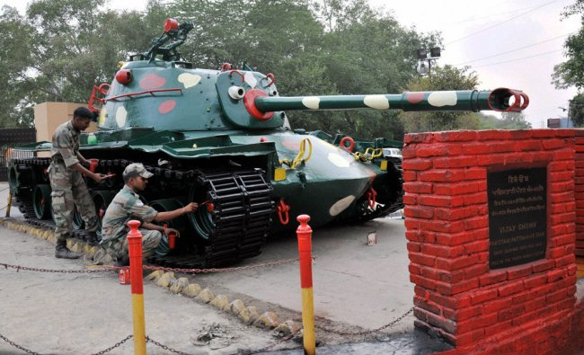 Army persons painting a Pakistani tank captured by Indian forces during 1965 Indo-Pak conflict ...