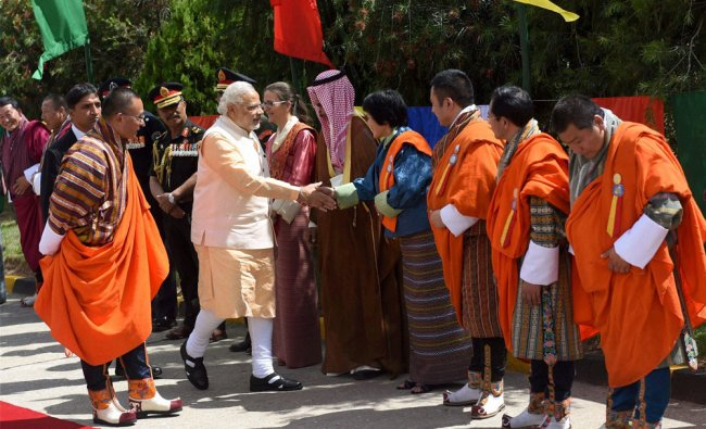 Narendra Modi greeting officials before his departure from Bhutan in Thimphu ...