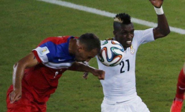 John Brooks of the U.S. (L) heads the ball to score a goal next to Ghana\'s John Boye during ...