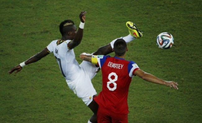 Ghana\'s John Boye (L) kicks high and knocks into the face of Clint Dempsey of the U.S....