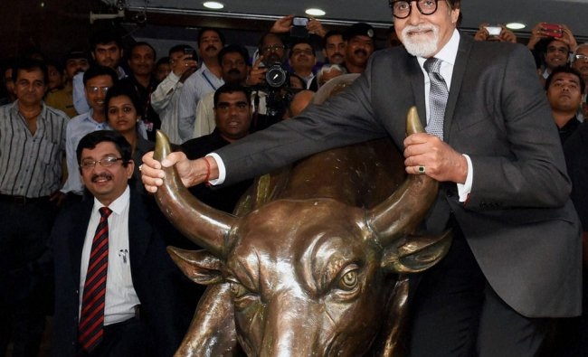 Amitabh Bachchan poses with the bull statue at BSE during a promotional event of his TV show ...
