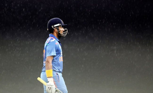 Robin Uthappa walks back to the pavilion after their second ODI due to rain ...